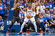 OKLAHOMA CITY, OK - APRIL 21: Nerlens Noel #3 of the Oklahoma City Thunder looks to make a pass while being defended by CJ McCollum #3 and Zach Collins #33 of the Portland Trail Blazers during Round One Game Three of the 2019 NBA Playoffs on April 21, 2019 at Chesapeake Energy Arena in Oklahoma City, Oklahoma  NOTE TO USER: User expressly acknowledges and agrees that, by downloading and or using this photograph, User is consenting to the terms and conditions of the Getty Images License Agreement.  The Trail Blazers defeated the Thunder 111-98.  (Photo by Wesley Hitt/Getty Images) *** Local Caption *** Nerlens Noel; Enes Kanter; CJ McCollum