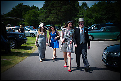 Racegoers arrive at Royal Ascot Day 2-Racing Fans<br /> Ascot, United Kingdom<br /> Wednesday, 19th June 2013<br /> Picture by Andrew Parsons / i-Images