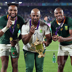 Lukhanyo Am with Mzwandile Stick (Backs Coach) of South Africa and Makazole Mapimpi during the Rugby World Cup Final match between South Africa Springboks and England Rugby World Cup Final at the International Stadium Yokohama  Japan.Saturday 02 November 2019. (Mandatory Byline -Steve Haag Sports Hollywoodbets)