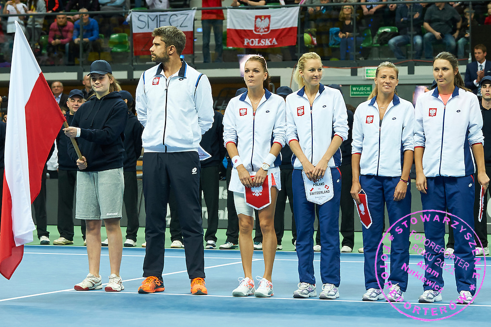 (L-R) Tomasz Wiktorowski - captain national team and Agnieszka Radwanska and Urszula Radwanska and Alicja Rosolska and Klaudia Jans-Ignacik all from Poland during the Fed Cup / World Group Play Off tennis match between Poland and Switzerland on April 18, 2015 in Zielona Gora, Poland<br /> Poland, Zielona Gora, April 18, 2015<br /> <br /> Picture also available in RAW (NEF) or TIFF format on special request.<br /> <br /> For editorial use only. Any commercial or promotional use requires permission.<br /> <br /> Adam Nurkiewicz declares that he has no rights to the image of people at the photographs of his authorship.<br /> <br /> Mandatory credit:<br /> Photo by &copy; Adam Nurkiewicz / Mediasport