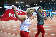 (L) Anita Wlodarczyk (first place and gold medal) and (R) Joanna Fiodorow (third place and bronze medal) both from Poland celebrate their medals in women's hammer throw final during the Fourth Day of the European Athletics Championships Zurich 2014 at Letzigrund Stadium in Zurich, Switzerland.<br /> <br /> Switzerland, Zurich, August 15, 2014<br /> <br /> Picture also available in RAW (NEF) or TIFF format on special request.<br /> <br /> For editorial use only. Any commercial or promotional use requires permission.<br /> <br /> Photo by © Adam Nurkiewicz / Mediasport