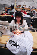 4/3/09 10:49:23 AM -- Easton, PA, U.S.A. -- Barbara Graver, a seamstress at Majestic Athletic sews lettering on the back of a Chicago White Sox jersey April 3, 2009 in Easton, Pennsylvania. White Sox jerseys and gear have experienced a boost in sales with Obama, a White Sox fan, in the White House. -- .Photo by William Thomas Cain,  cainimages.com.