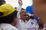 Opposition party leader Sam Rainsy of the CNRP is giving a speech during an election campaign rally in Kampong Cham, Cambodia.