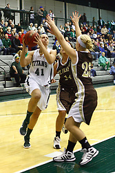 17 December 2011:  Karen Solari heads for the hoop defended by Michelle Karr to her left and Cydney Weisflog in the front during an NCAA womens division 3 basketball game between the St. Francis Fighting Saints and the Illinois Wesleyan Titans in Shirk Center, Bloomington IL