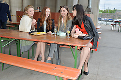 Left to right, AMBER ATHERTON, OLIVIA GRANT, AMBER LE BON and LILAH PARSONS at a supper and screening of 'No More Tiaras' a film by Mary Nighy held at Shrimpy's, King's Cross Filling Station, Goods Way, London on 7th May 2014.