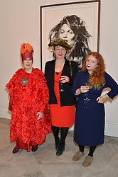 Left to right, MOLLY PARKIN, SOPHIE PARKIN and CARSON PARKIN at a private view of photographs by David Bailey entitled 'Bailey's Stardust' at the National Portrait Gallery, St.Martin's Place, London on 3rd February 2014.