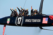 Oracle Team USA celebrates after defeating Emirates Team New Zealand in Race 17 of the America's Cup Finals on Tuesday, September 24, 2013 in San Francisco, Calif.