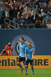 August 22, 2018 - Bronx, New York, United States - New York City forward DAVID VILLA (7) celebrates his goal with New York City defender BEN SWEAT (2) during a regular season match at Yankee Stadium in Bronx, NY.  New York City FC tie the New York Red Bulls 1 to 1 (Credit Image: © Mark Smith via ZUMA Wire)