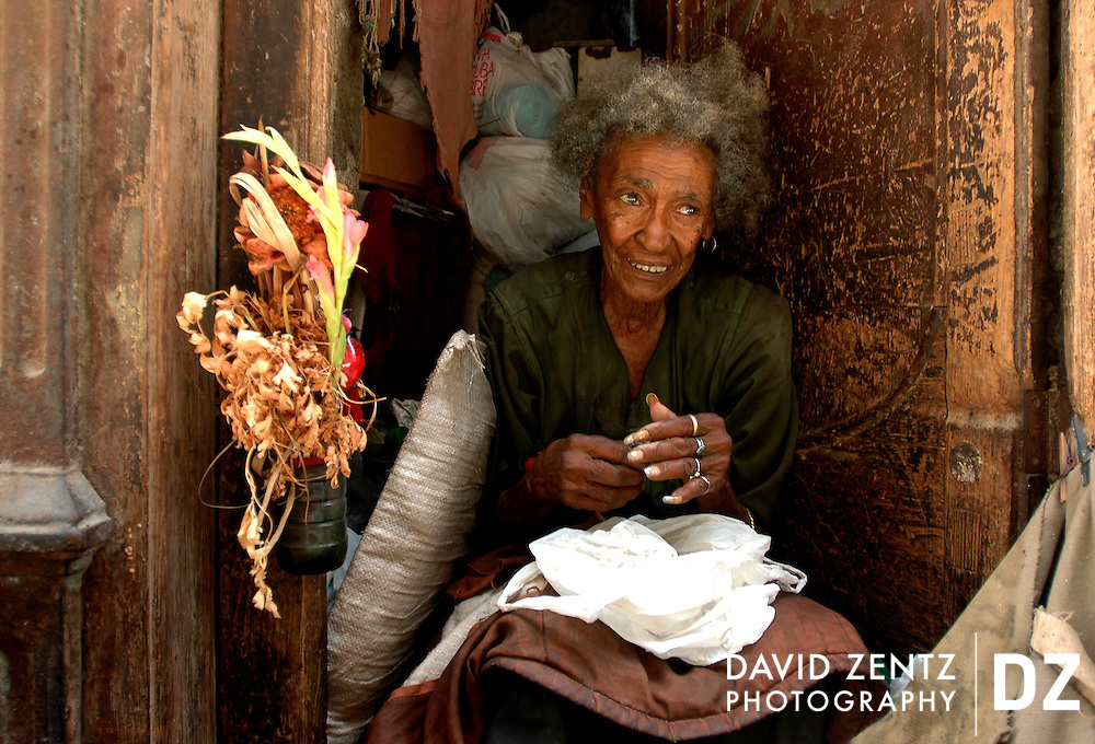 An elderly woman by the name of Diñora sits in her doorway on a less-travelled side street in the Old Havana district of Havana, Cuba in May 7, 2005.