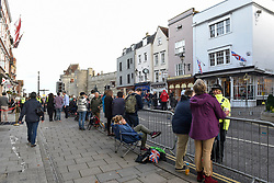 © Licensed to London News Pictures. 12/10/2018. WINDSOR, UK.  Crowds gather in Windsor for the royal wedding of Princess Eugenie and Jack Brooksbank.  Princess Eugenie, 28, the younger daughter of the queen's third child Prince Andrew and his ex-wife Sarah Ferguson, the Duchess of York, will marry Jack Brooksbank, a 32-year-old drinks executive, in Windsor Castle before taking part in a short carriage procession through Windsor town.  This is the second royal wedding in Windsor in 2018, Prince Harry married Meghan Markle in May.  Photo credit: Stephen Chung/LNP