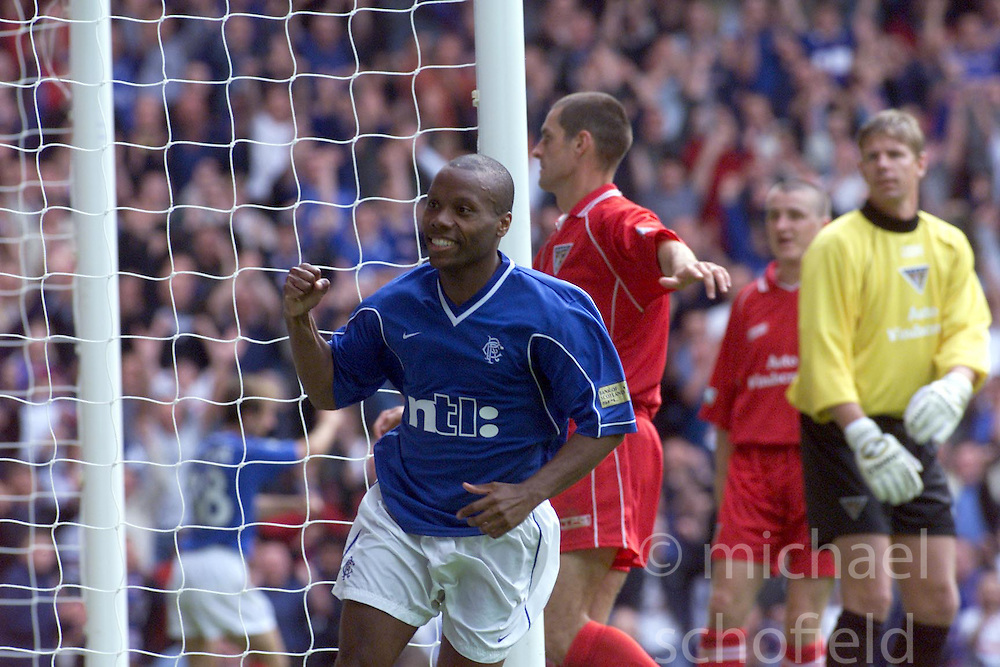 Rod Wallace celebrates after scoring their fourth goal, during a Rangers v Dunfermline game in August 2000..