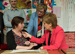 Scottish National Party leader, Nicola Sturgeon, joins Council candidates in Edinburgh to launch the SNP's manifesto for the 2017 Local Government election.<br /> <br /> Pictured: First Minister, Nicola Sturgeon with a user of the WHALE Community Arts Centre