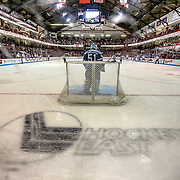 The Hockey East logo is seen on the ice while Martin Ouellette #51 of the Maine Black Bears is in net during the game at Matthews Arena on February 22, 2014 in Boston, Massachusetts. (Photo by Elan Kawesch)