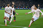 GOAL - 1-3 Manchester United Forward Marcus Rashford celebrates with Manchester United forward Mason Greenwood and Manchester United Midfielder Fred during the Champions League Round of 16 2nd leg match between Paris Saint-Germain and Manchester United at Parc des Princes, Paris, France on 6 March 2019.