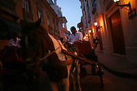 """The driver of a horse drawn buggy waits for clients on the streets of the """"Old City"""" in Cartagena, a unique travel destination on Colombia's Caribbean coast. (Photo/Scott Dalton)"""