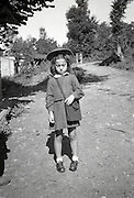 unhappy girl ready for going to school countryside 1950s