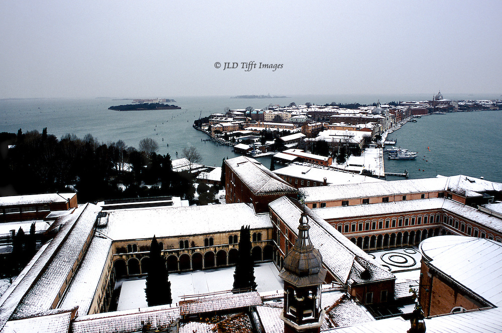 Venice under snow seen from the campanile of the Palladian church of San Giorgio Maggiore. Below, the San Giorgio monastery with Giudecca beyond.