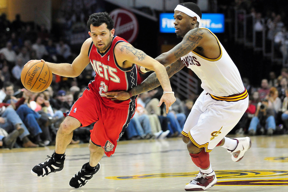 March 23, 2010; Cleveland, OH, USA; New Jersey Nets point guard Jordan Farmar (2) drives past Cleveland Cavaliers point guard Daniel Gibson (1) during the second quarter at Quicken Loans Arena. Mandatory Credit: Jason Miller-US PRESSWIRE