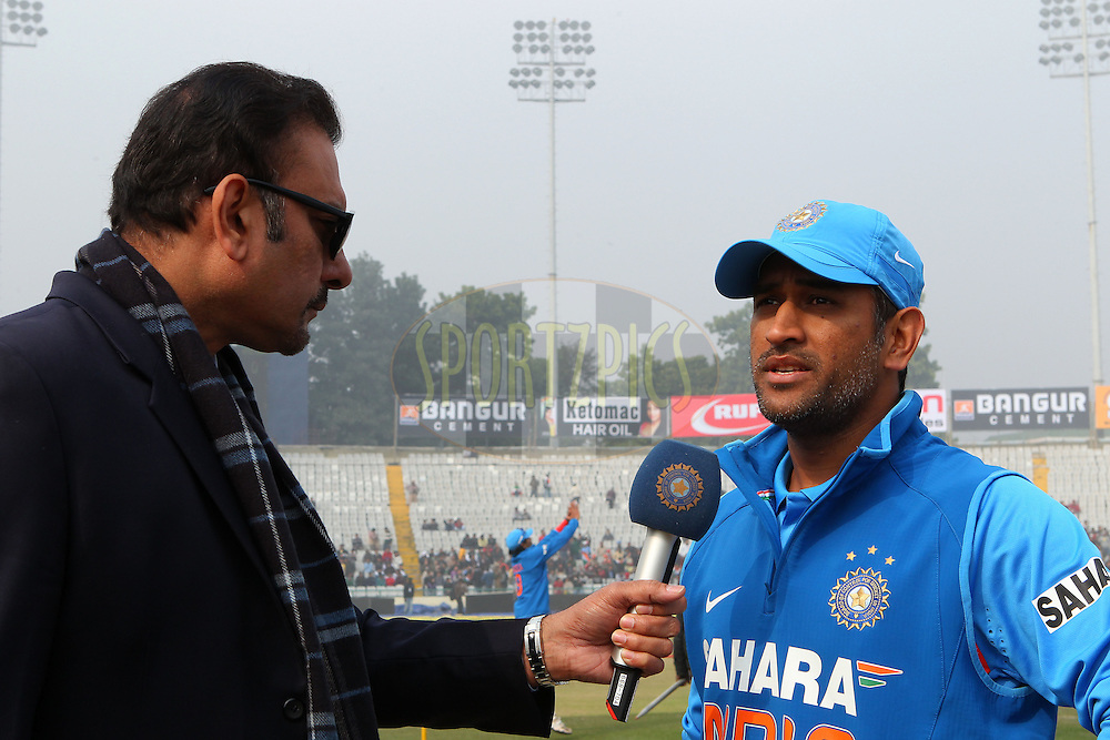 Ravis Shastri interviews MS Dhoni of India  after the toss during the 4th Airtel ODI Match between India and England held at the PCA Stadium, Mohal, India on the 23rd January 2013..Photo by Ron Gaunt/BCCI/SPORTZPICS ..Use of this image is subject to the terms and conditions as outlined by the BCCI. These terms can be found by following this link:..http://www.sportzpics.co.za/image/I0000SoRagM2cIEc