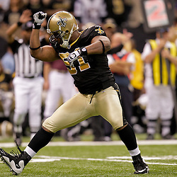 2009 November 30:  New Orleans Saints defensive end Will Smith (91) celebrates after a sack during a 38-17 win by the New Orleans Saints over the New England Patriots at the Louisiana Superdome in New Orleans, Louisiana.