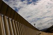 The border fence seperating the U.S. from Mexico runs near Tijuana, Mexico on Monday, March 28, 2005.<br />