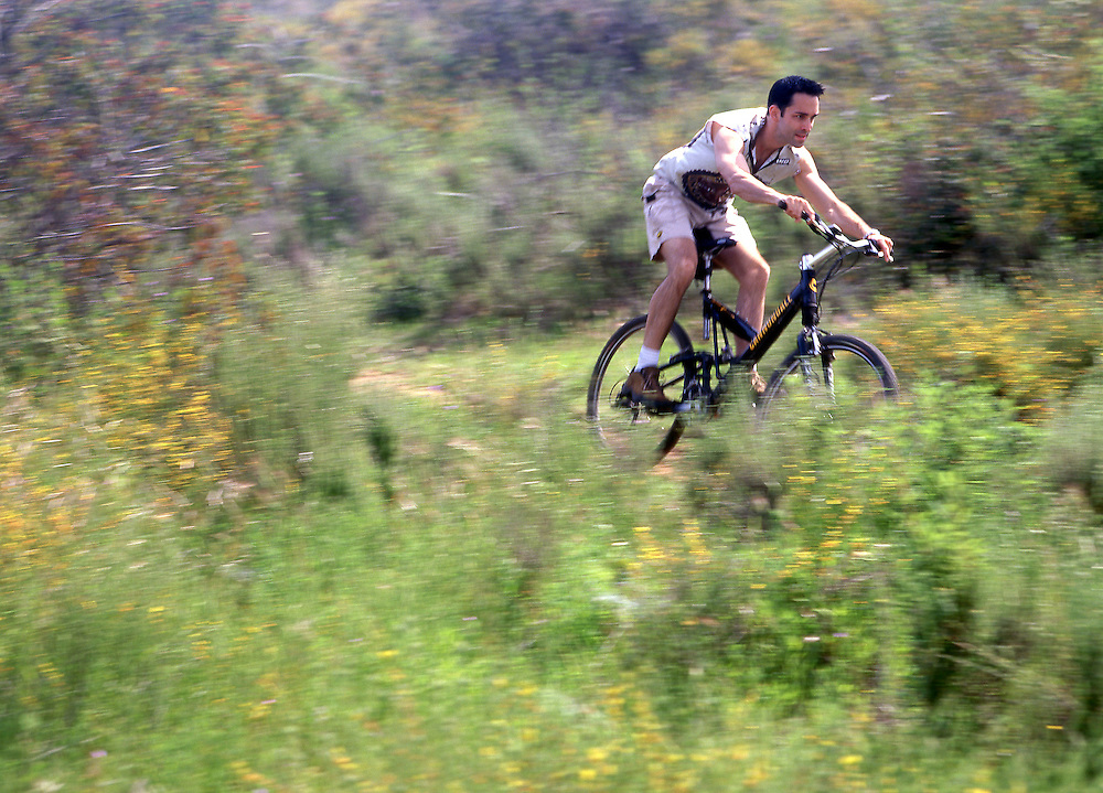 BMX Biker on grassy trails in San Diego, CA