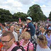 Spectators try and catch a glimpse of Mary King, Great Britain, riding Imperial Cavalier as she navigates a difficult jump during the Cross Country event in the Eventing competition in front of massive crowds at Greenwich Park  during the London 2012 Olympic games. London. UK. 29th July 2012. Photo Tim Clayton