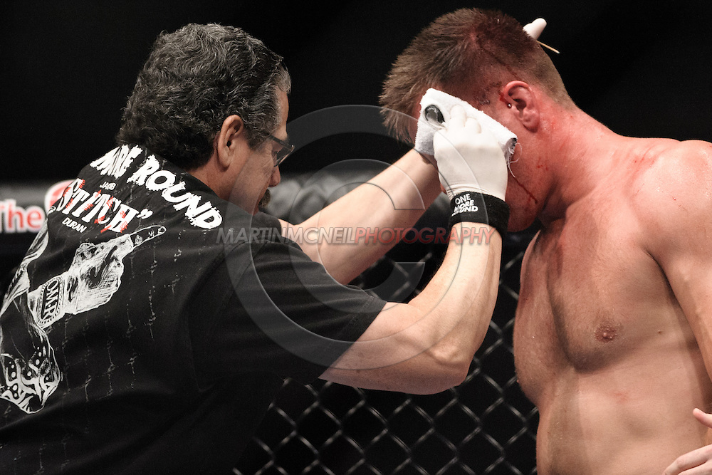 """LONDON, ENGLAND, JUNE 7, 2008: Jacob Duran (left) tends to a cut on Antoni Hardonk's head during """"UFC 85: Bedlam"""" inside the O2 Arena in Greenwich, London on June 7, 2008."""