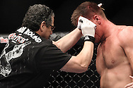 "LONDON, ENGLAND, JUNE 7, 2008: Jacob Duran (left) tends to a cut on Antoni Hardonk's head during ""UFC 85: Bedlam"" inside the O2 Arena in Greenwich, London on June 7, 2008."