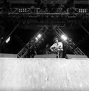 Donavon singing on stage with a guitar, Glastonbury, Somerset, 1989