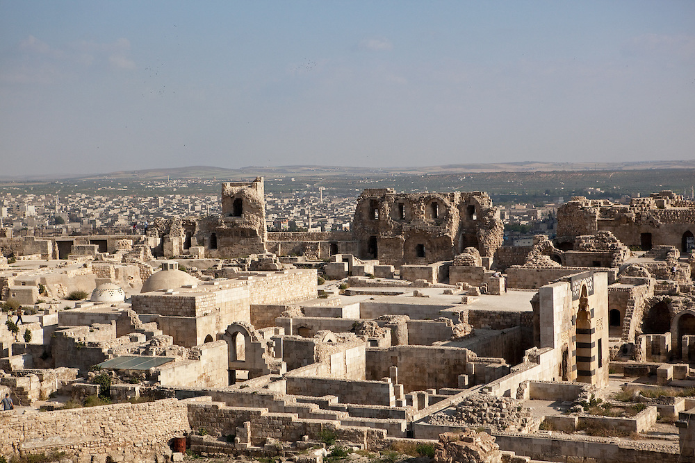View over the ruins of the Citadel and beyond, the modern city of Aleppo, Syria