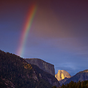 Mountains against rainbow