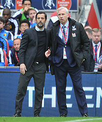 ALAN PARDEW MANAGER CRYSTAL PALACE SHAKES HANDS WITH WATFORD MANAGER QUIQUE SANCHEZ FLORES ON THE FINAL WHISTLE, ALAN PARDEW MANAGER CRYSTAL PALACE, Crystal Palace v Watford Emirates FA Cup Semi Final Wembley Stadium Sunday 24th April 2016, Score Palace 2-1 (Bolasie, Wickham) Watford 1 (Deeney)