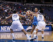 Alana Beard and Lindsey Harding block an attempt by Atlanta Dream's Iziane Castro Marques during the Mystics' final home game September 12, 2009 at the Verizon Center in Washington, DC.
