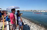 新华社照片,洛杉矶,2017年7月31日<br />     (国际)(5)第二十一届加州长滩龙舟节<br />     7月30日,民众在岸边观赛。<br />     在美国洛杉矶长滩市海滨体育场举行的第二十一届年度长滩龙舟节,吸引百余队上千选手参赛。长滩龙舟节是加州最大的龙舟比赛,同时也展示了中国古代龙舟赛的运动。<br />     新华社发(赵汉荣摄)<br /> People watch the 500-meter race at the 21st Annual Long Beach Dragon Boat Festival at Marine Stadium in Long Beach, California, the United States, on July 30, 2017. The Long Beach Dragon Boat Festival is held every year in July at Marine Stadium to hosting the largest dragon boat competitions in California. It showcases the ancient Chinese sport of dragon boat racing. (Xinhua/Zhao Hanrong)(Photo by Ringo Chiu)<br /> <br /> Usage Notes: This content is intended for editorial use only. For other uses, additional clearances may be required.