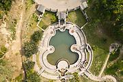 Laghetto delle danze, aerial view, a violin-shaped stone pond in memory of Gasparo da Salo, inventor of the violin, where small quartet recitals were held, at the Vittoriale degli italiani, or The Shrine of Italian Victories, the home, estate and museums of Gabriele D'Annunzio, 1863-1938, Italian writer, soldier and fascist, at Gardone Riviera, Lake Garda, Brescia, Lombardy, Italy. The estate consists of the Prioria, where d'Annunzio lived 1922-38, an amphitheatre, the protected cruiser Puglia, the MAS vessel used by D'Annunzio in 1918 and a mausoleum. It is part of the Grandi Giardini Italiani. Picture by Manuel Cohen