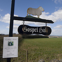 Painted metal sign indicating Gospel Hall Farm in the Scottish Borders. Rev Antony Jones of the Ruberslaw parish carried out an open air lambing service at Gospel Hall Farm at Lanton near Jedburgh. The Minister read about the tradition from centuries ago and was keen to bring it back.&#xA;<br />