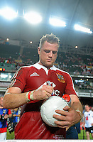 1 June 2013; Jamie Heaslip, British & Irish Lions, autographs a gaelic football after the match. British & Irish Lions Tour 2013, Barbarians v British & Irish Lions, Hong Kong Stadium, So Kon Poh, Hong Kong, China. Picture credit: Stephen McCarthy / SPORTSFILE