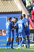 Lyle Taylor of AFC Wimbledon volleys wimbledon into an early lead during the Sky Bet League 2 match between AFC Wimbledon and Barnet at the Cherry Red Records Stadium, Kingston, England on 3 October 2015. Photo by Stuart Butcher.
