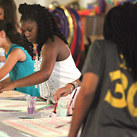 Danyla Walker, 12, of Tupelo, paints her on bulletin board art project during the art portion of SHINE Camp at HealthWorks in Tupelo. SHINE Camp is week long camp put on by the Junior Auxiliary of Tupelo for upcoming middle school girls that promotes positive self-esteem through devotions, drama, art, physical excerise and group discussions.