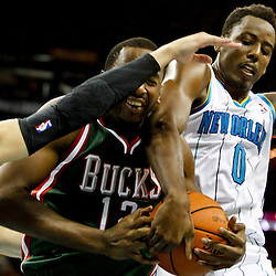 Dec 3, 2012; New Orleans, LA, USA; Milwaukee Bucks power forward Ekpe Udoh (13) is defended by New Orleans Hornets small forward Al-Farouq Aminu (0) and shooting guard Austin Rivers (25) during the second half of a game at the New Orleans Arena. The Hornets defeated the Bucks 102-81.  Mandatory Credit: Derick E. Hingle-USA TODAY Sports