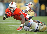 Mike James earns a first down in the fourth quarter as he is taken down by Tech's Isaiah Johnson. The University of Miami vs Georgia Tech in football at Bobby Dodd Stadium/Grant Field in Atlanta on Saturday, September 22, 2012