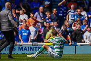Mikael Lustig sits on the Ibrox turf and reminds the fans of how many titles his club have just secured during the Ladbrokes Scottish Premiership match between Rangers and Celtic at Ibrox, Glasgow, Scotland on 12 May 2019.