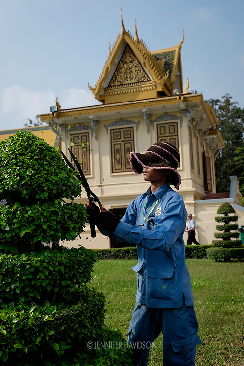 A gardener trims topiaries on the grounds of the Royal Palace in Phnom Penh, Cambodia.
