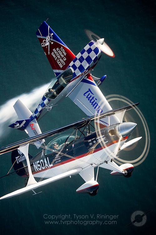 Photoflight over Monterey Bay with Sean D. Tucker in the Pitts S2B and Eric Tucker in the Extra 300L for the Tutima Academy of Aviation Safety.