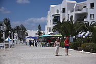 Scenes from Tunisia's resort area, El Kantouai,tourists walking through marina-condo area