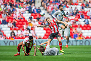 Ben Close (#33) of Portsmouth FC outjumps Max Power (#6) of Sunderland AFC for a header during the EFL Sky Bet League 1 match between Sunderland and Portsmouth at the Stadium Of Light, Sunderland, England on 17 August 2019.