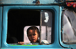 60889148 <br /> A child looks through a truck window in Kabul, Afghanistan, Monday, 6th January 2014. Picture by  imago / i-Images<br /> UK ONLY
