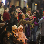 Spectators watch the 12th Annual Wilmington Holiday Parade Sunday December 7, 2014 in Wilmington, N.C. (Jason A. Frizzelle)
