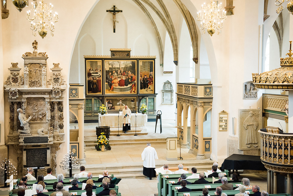 The Rev. Dr. Michael Kumm, chairman of the LCMS Board of Directors, kneels at the altar during the Festival Dedication Service at the Town and Parish Church of St. Mary's before the dedication of The International Lutheran Center at the Old Latin School on Sunday, May 3, 2015, in Wittenberg, Germany. LCMS Communications/Erik M. Lunsford